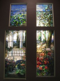 By Window by studio of Louis Comfort Tiffany, via Wikimedia Commons